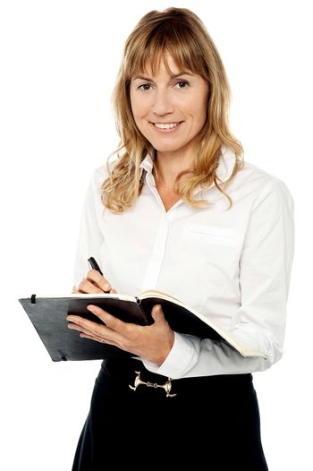 Cheerful female assistant writing notes