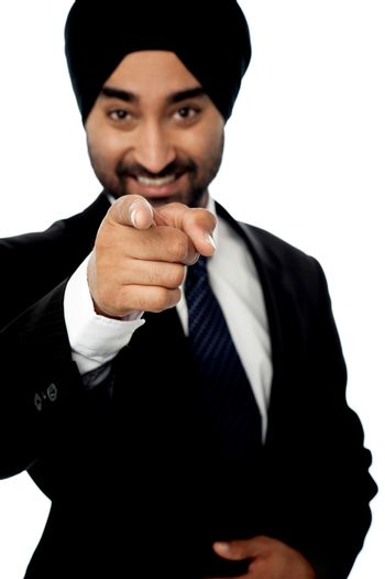 Corporate man pointing towards you