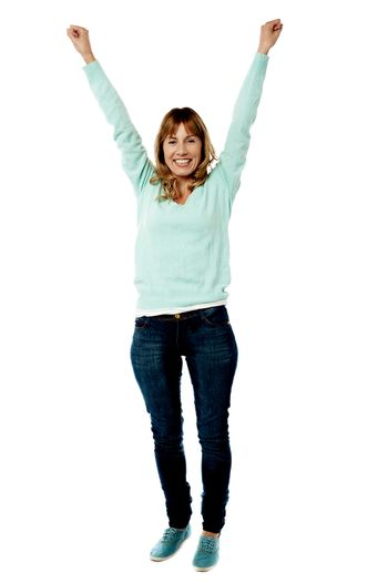 Female raising her arms in excitement