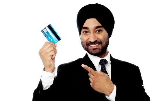 Businessman holding up credit card