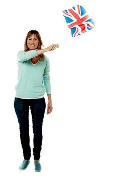 Lady UK supporter waving national flag