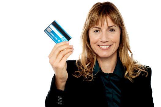 Businesswoman displaying cash card