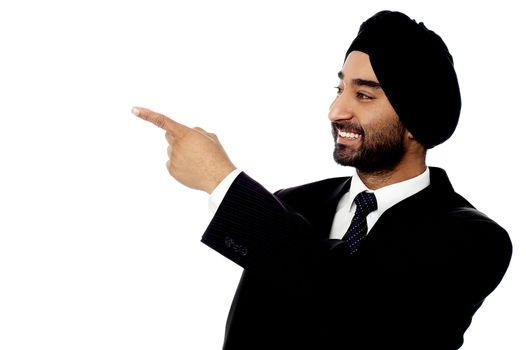 Indian businessman pointing away