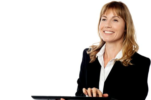 Cheerful corporate lady at work