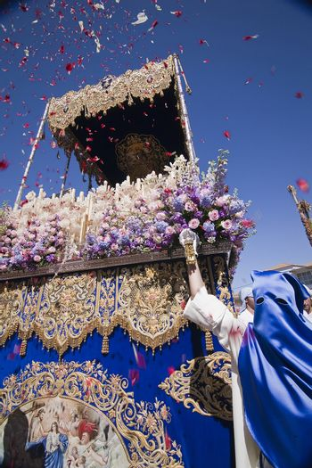 Rain of rose petals on the throne of the Virgen del Amor Hermoso during Holy week in Linares, province Jaen, Andalusia, Spain