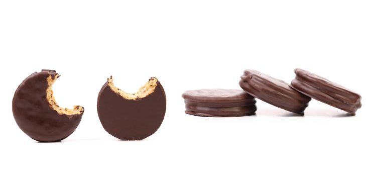 Bitten biscuit sandwich with chocolate.