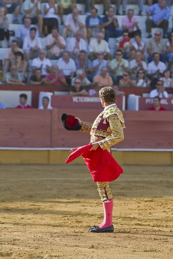The Spanish Bullfighter Jose Luis Moreno provides to the public at the beginning of the Bullfight in the Bullring of the Pozoblanco, Spain, 5 september 2010