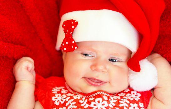 Sweet newborn baby on Christmastime