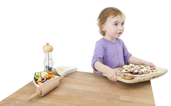 child with home made pizza. studio shot isolated on white background