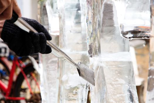 Ice Carver Using Chisel to Carve