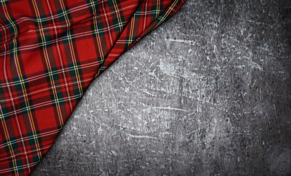 tartan textile on stone background
