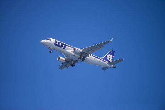 Lot, Polish Airlines, Poland, Embraer 175. The pictures of the planes are shot very close an airport just before landing. September 2013.