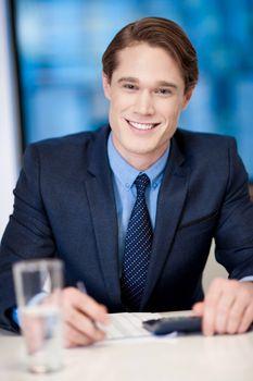Handsome businessman at work