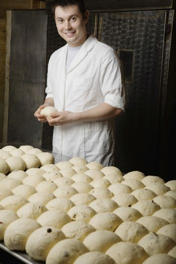 Baker With Balls of Bread Dough Ready to Bake