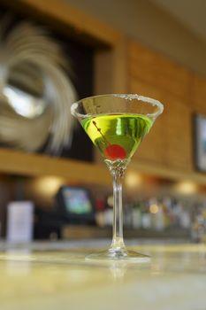 Closeup of a martini on bar counter
