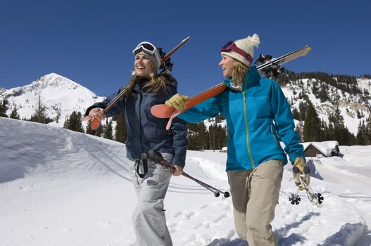 Skiers Carrying Skis on Mountain
