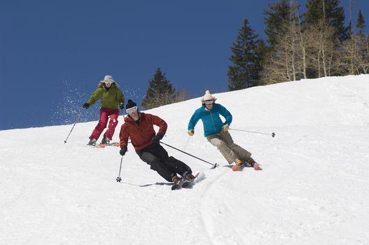 Skiers Skiing Down Slope