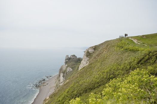 Couple on a Path Atop a Cliff
