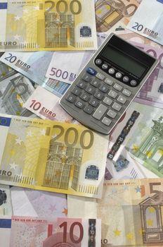 Closeup of calculator on Euro notes