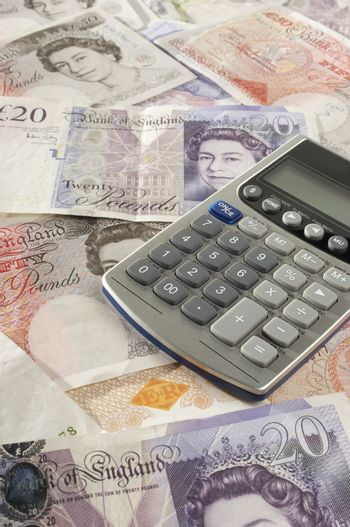 Closeup of British paper currency and calculator