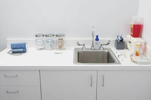 Closeup of disinfection sink and cabinets at clinic