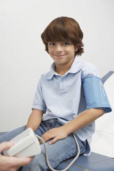 Boy having blood presure taken