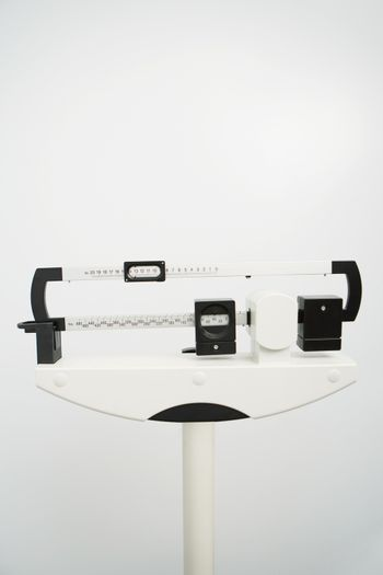 Closeup of white medical weight scale in clinic