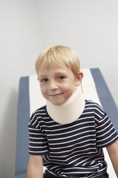 Boy wearing neck brace in hospitalportrait