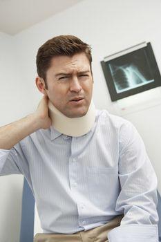 Man wearing neck brace in hospital