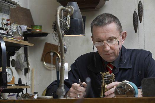 Clock Repairman at Work