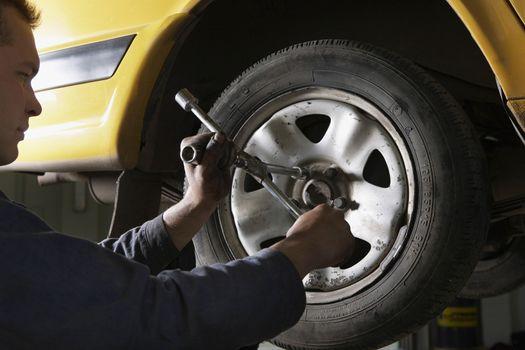 Mechanic Working on Tire
