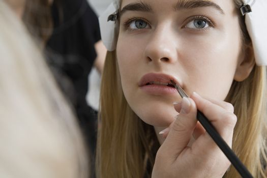 Model Having Makeup Applied