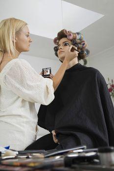Makeup Artist Preparing Model