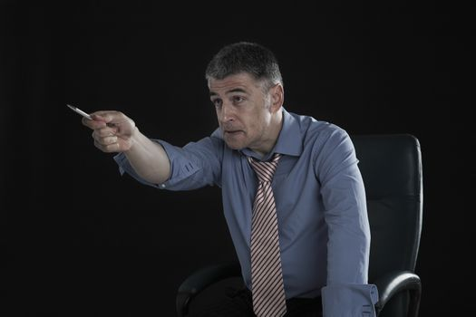 Angry Businessman Pointing a Pen