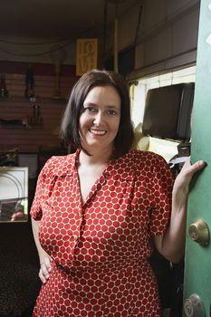 Second Hand Store Owner Standing in Doorway