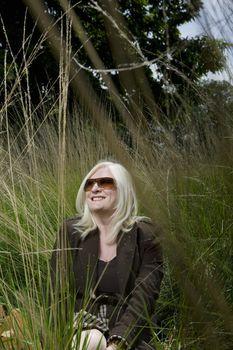 Woman Sitting in Tall Grass