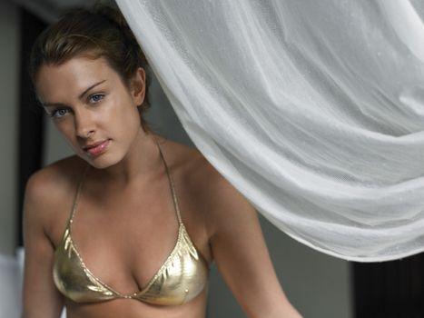 Young Woman in Bikini by Curtain