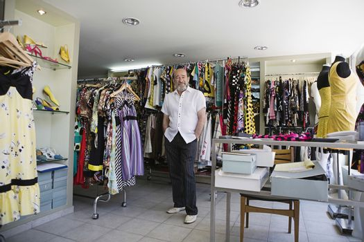 Shop Owner in Clothing Store