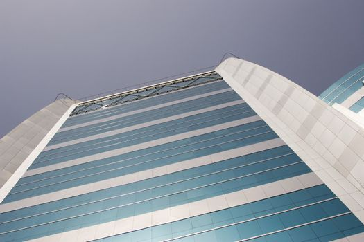 Low angle view of tall commercial building in Deira, Dubai, UAE