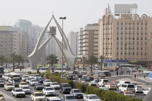 Over view of road traffic by the roundabout Clock Tower on Al-Maktoum Road, Dubai, UAE