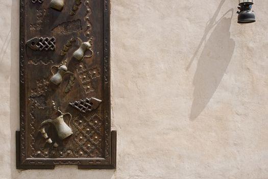 Dubai UAE Ornately decorated wood doors at Heritage Village in Bur Dubai