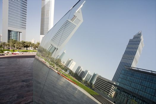 UAE Dubai reflection in a mirrored piece of artwork on display at the Dubai International Financial Centre