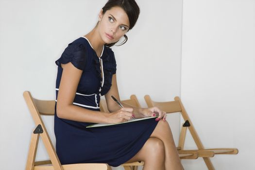 Woman writing looking away