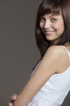 Young woman posing in tank top