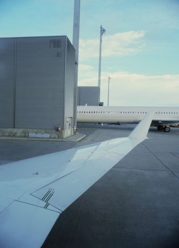 Detail of airplane wing in airport