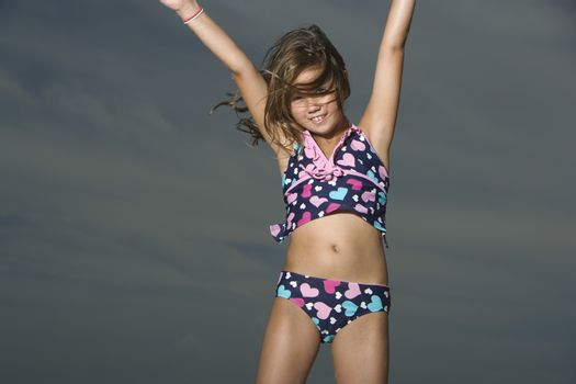 Little Girl in a Swimsuit Jumping