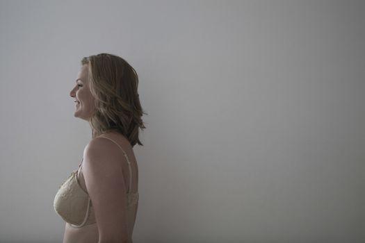 Portrait of semi-dress mid adult woman