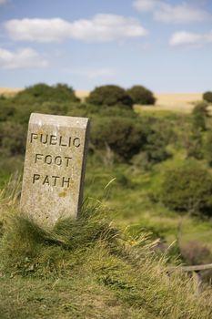 Closeup of stone sign marking public footpath
