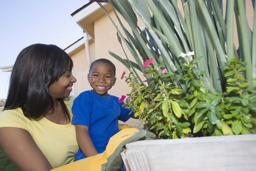 Woman and son tending plants