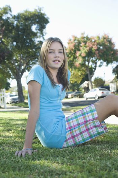 Teenage girl sitting on grass
